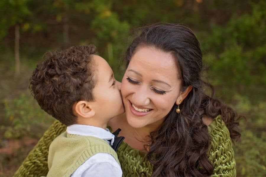 child giving mom a kiss