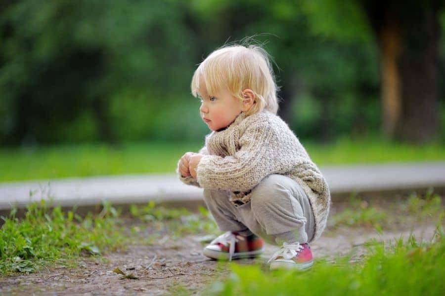 toddler playing outdoors
